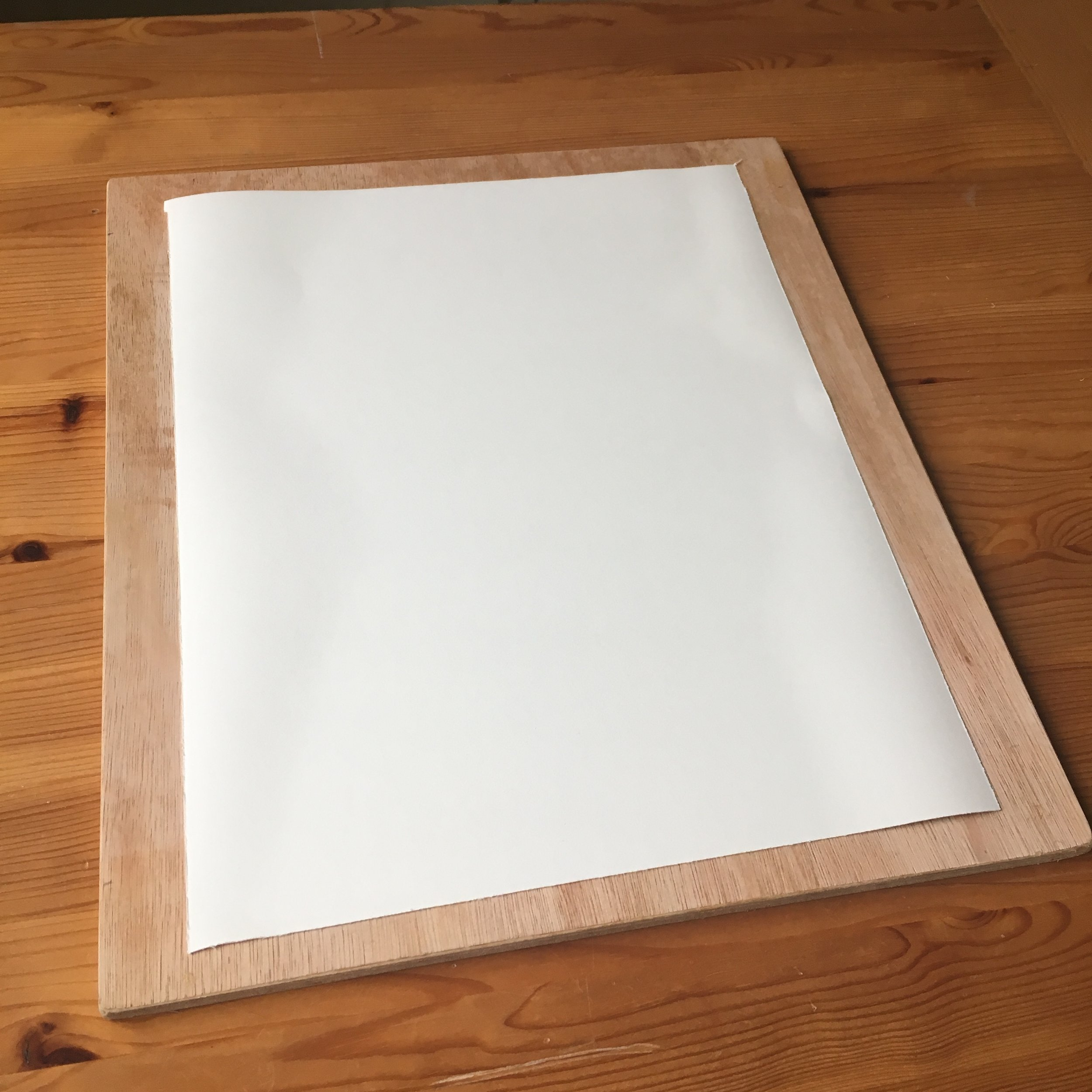 Ensure you have enough board surrounding your paper to allow the gummed tape to stick.