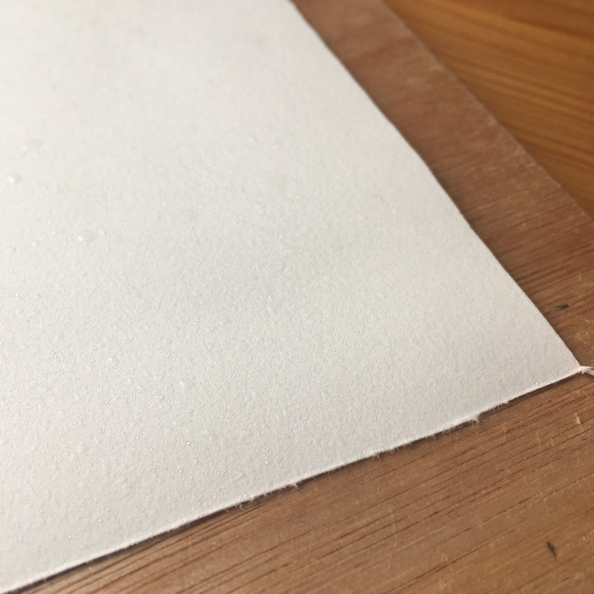 Hopefully you can see here the amount of water I apply to the paper. No large puddles or soaks in the bath are necessary - in doing so, you can disrupt the sizing (what holds the fibres together) in the paper.