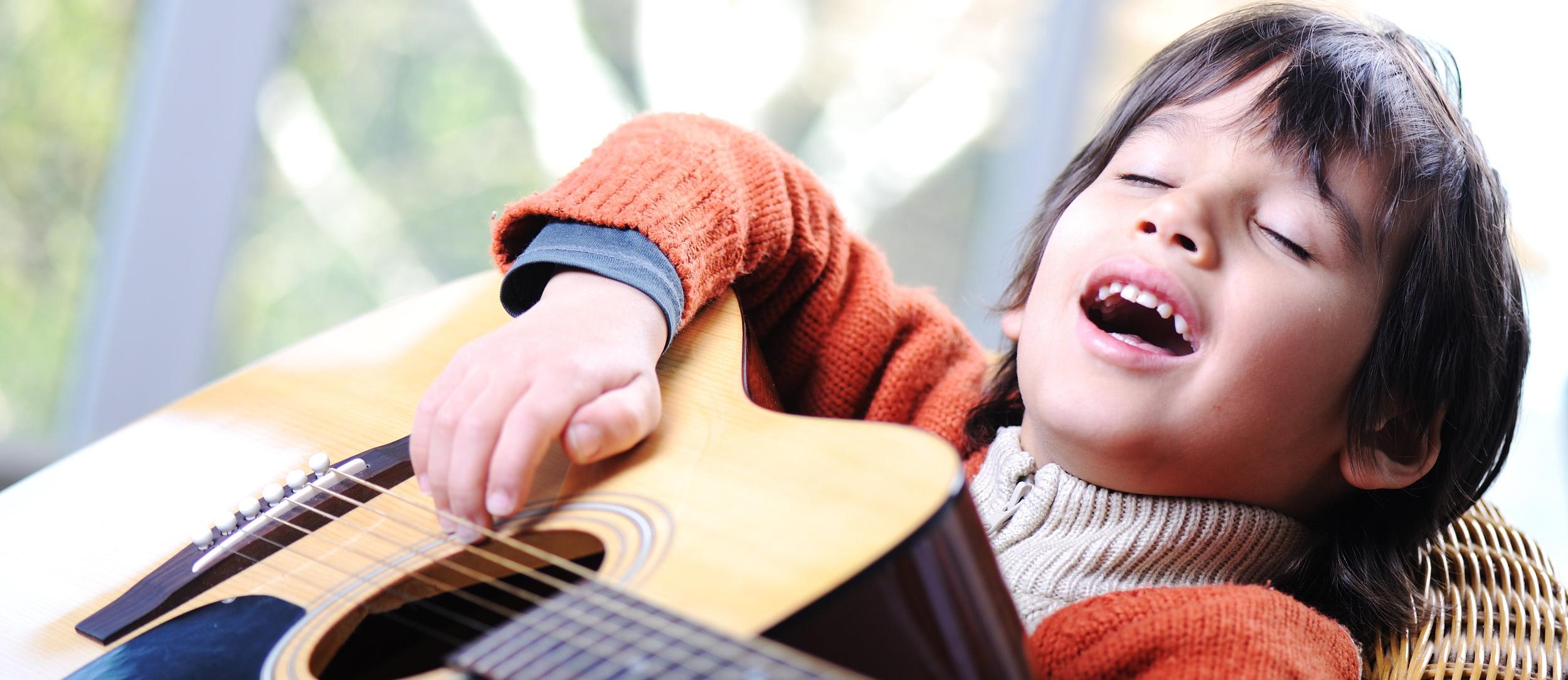 shutterstock_92907151 boy with guitar.jpg