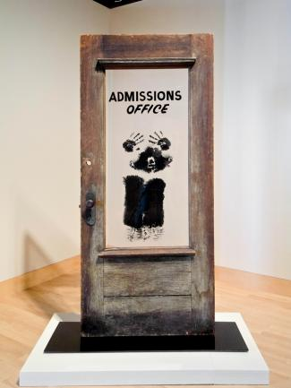 """David Hammons:  The Door (Admissions Office)  , 1969, wood, acrylic sheet and pigment, 79 by 48 by 15 inches; in """"Witness"""" at the Brooklyn Museum."""
