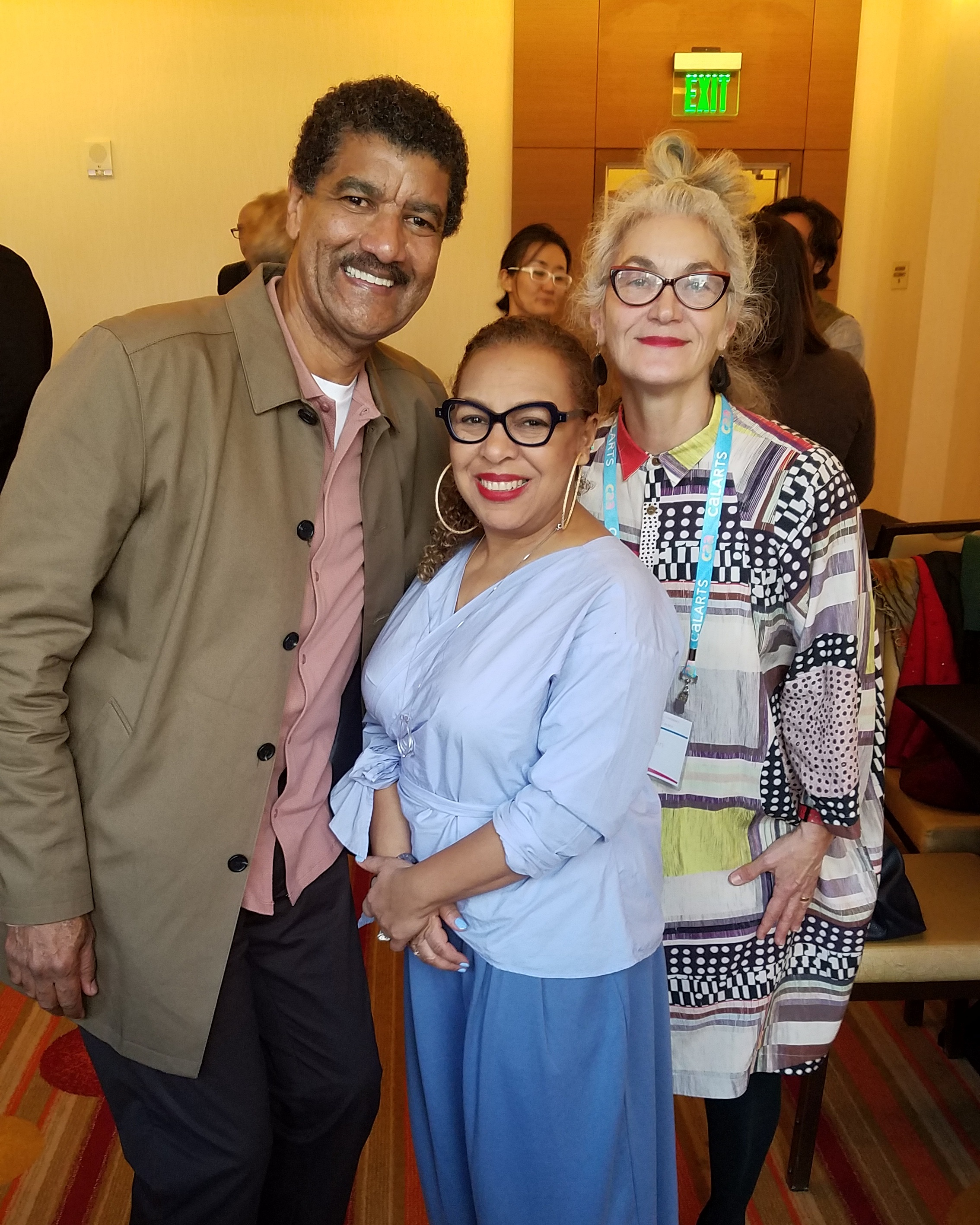 Kellie Jones with Pepón Osorio, recipient of the  2018 Distinguished Artist Award for Lifetime Achievement , and his wife, Merián Soto.