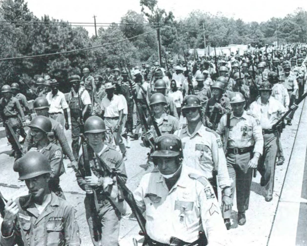 Hicks and the young Brothers lead the 105 mile, 10-day Civil Rights March from Bogalusa to Baton Rouge; Louisiana State Capital in 1967.