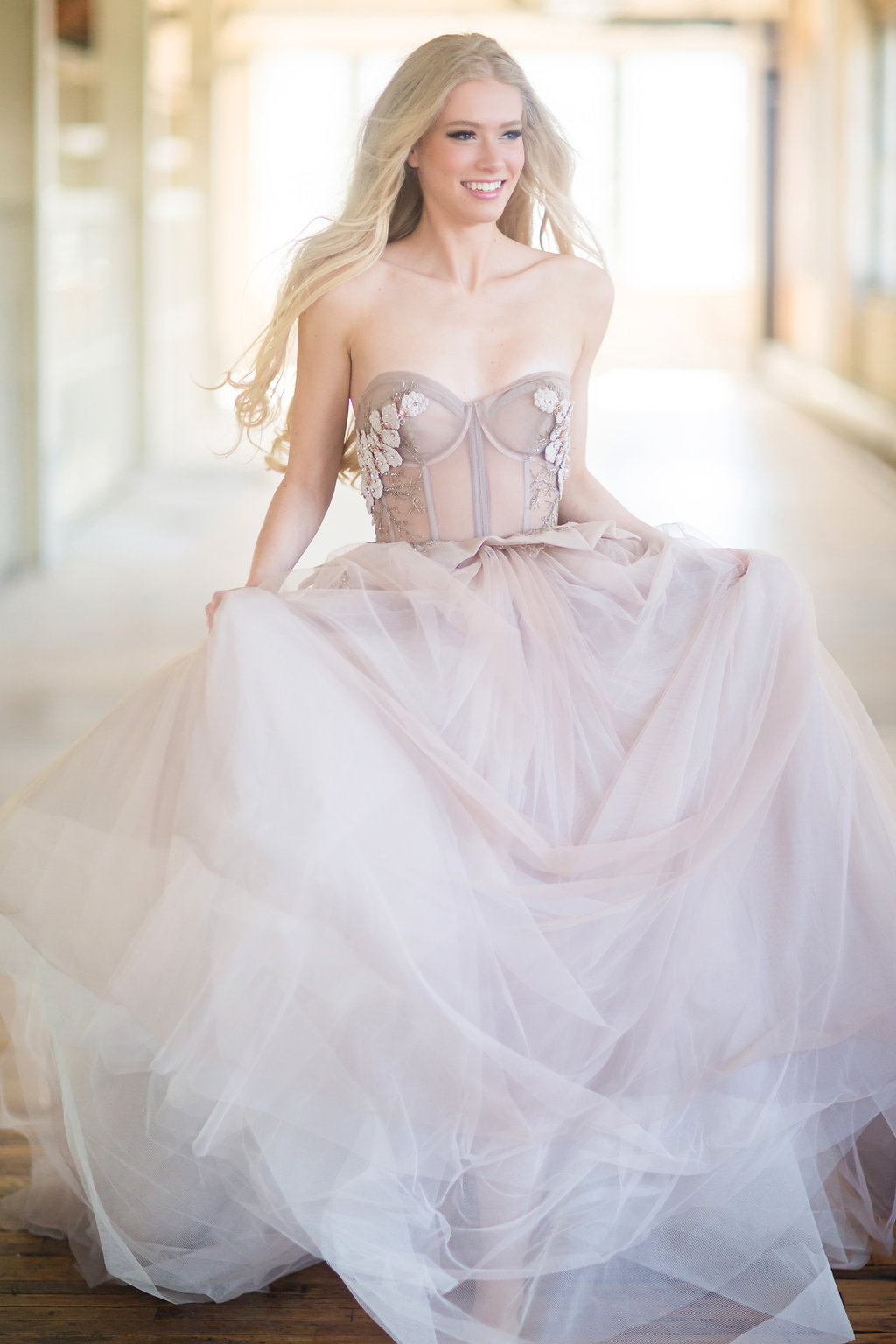 Photo by Cadence and Eli, Dress by Inbal Dror from L'atelier Coutrue, Hair by Julie Swenson, Makeup by Heather Trachsel, photos taken at The Machine Shop, Model is Lauren Schmidt