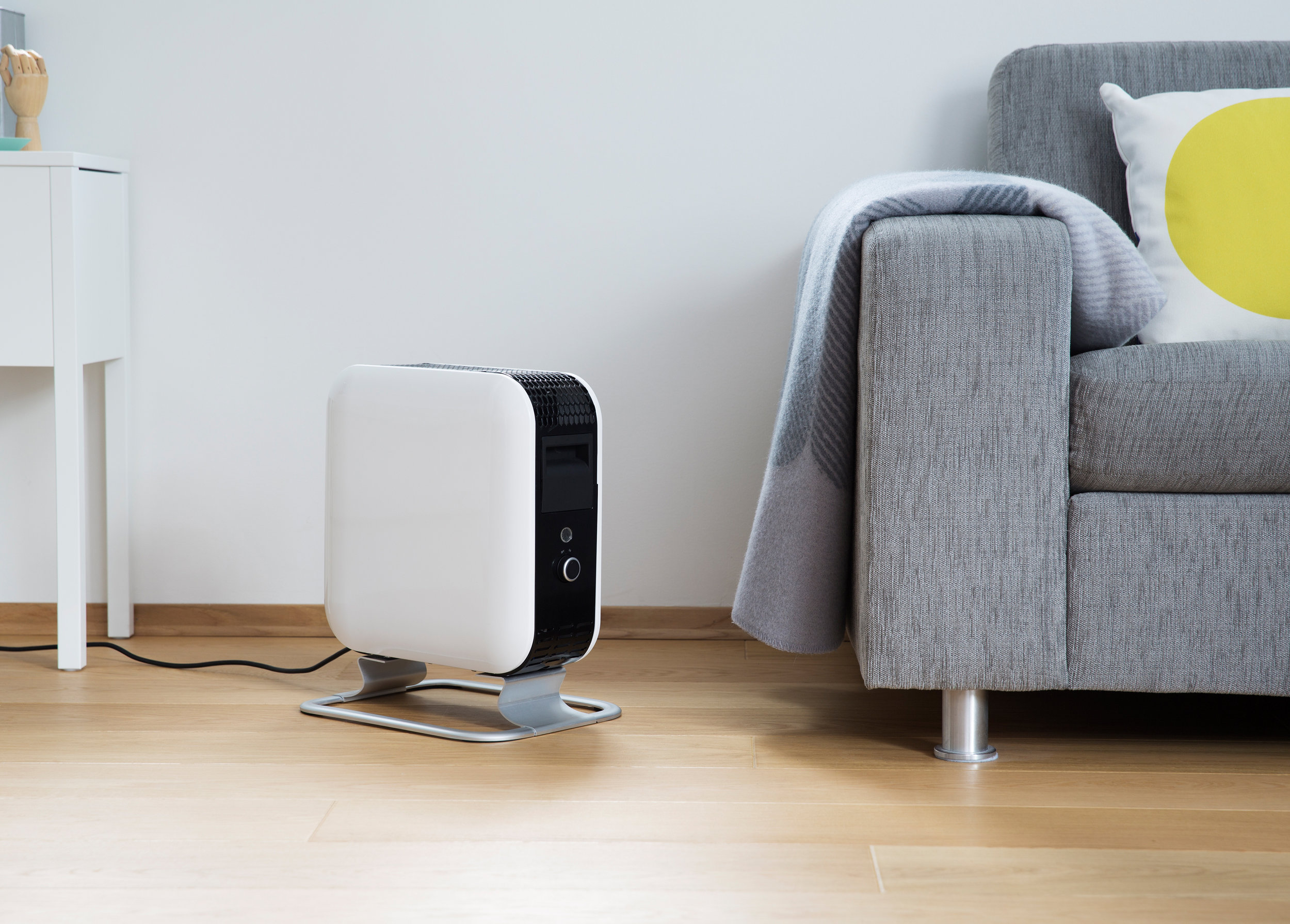 Mill heater next to the sofa