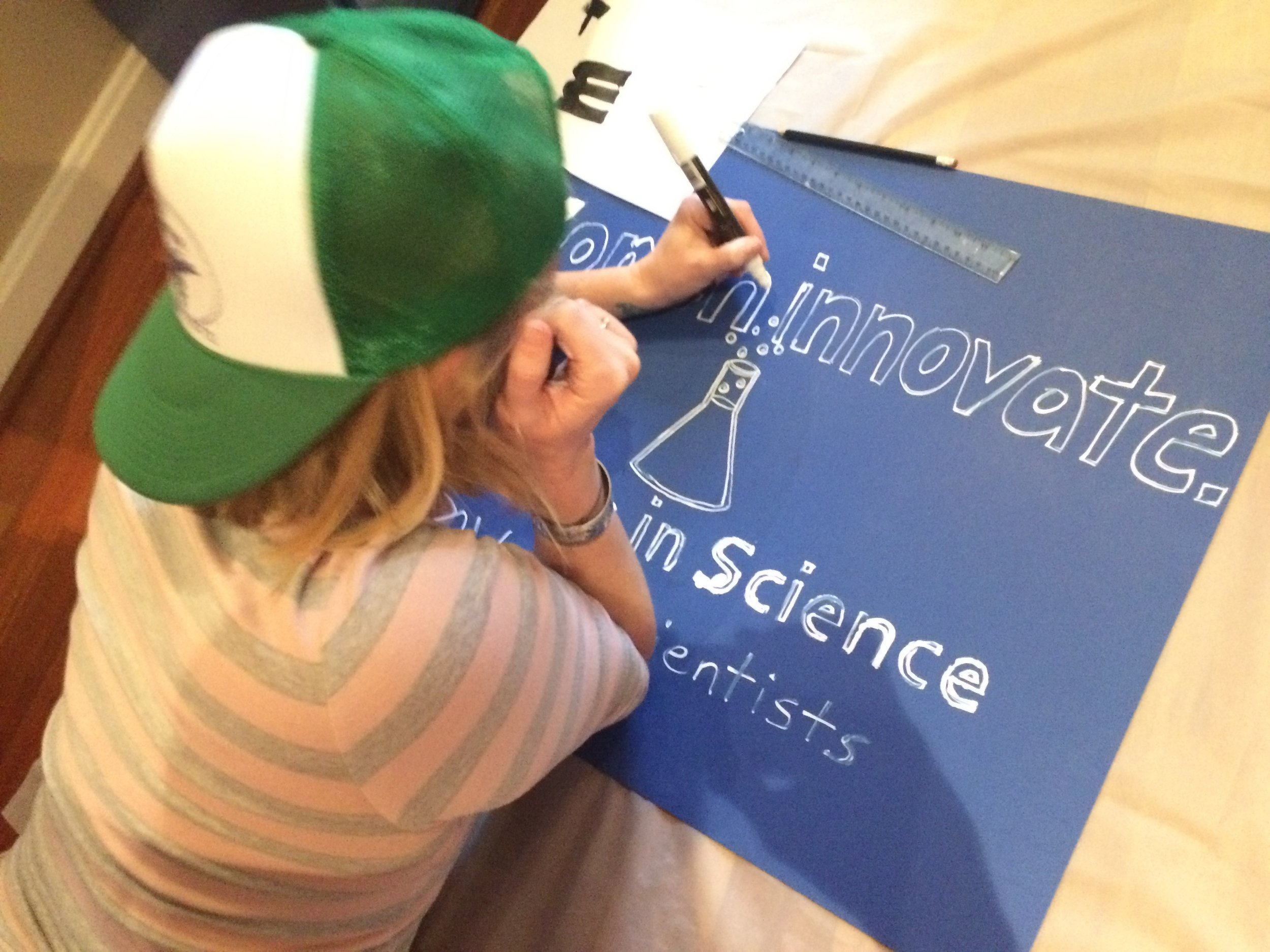 A DC Pod member making a sign for the Women's March on Washington