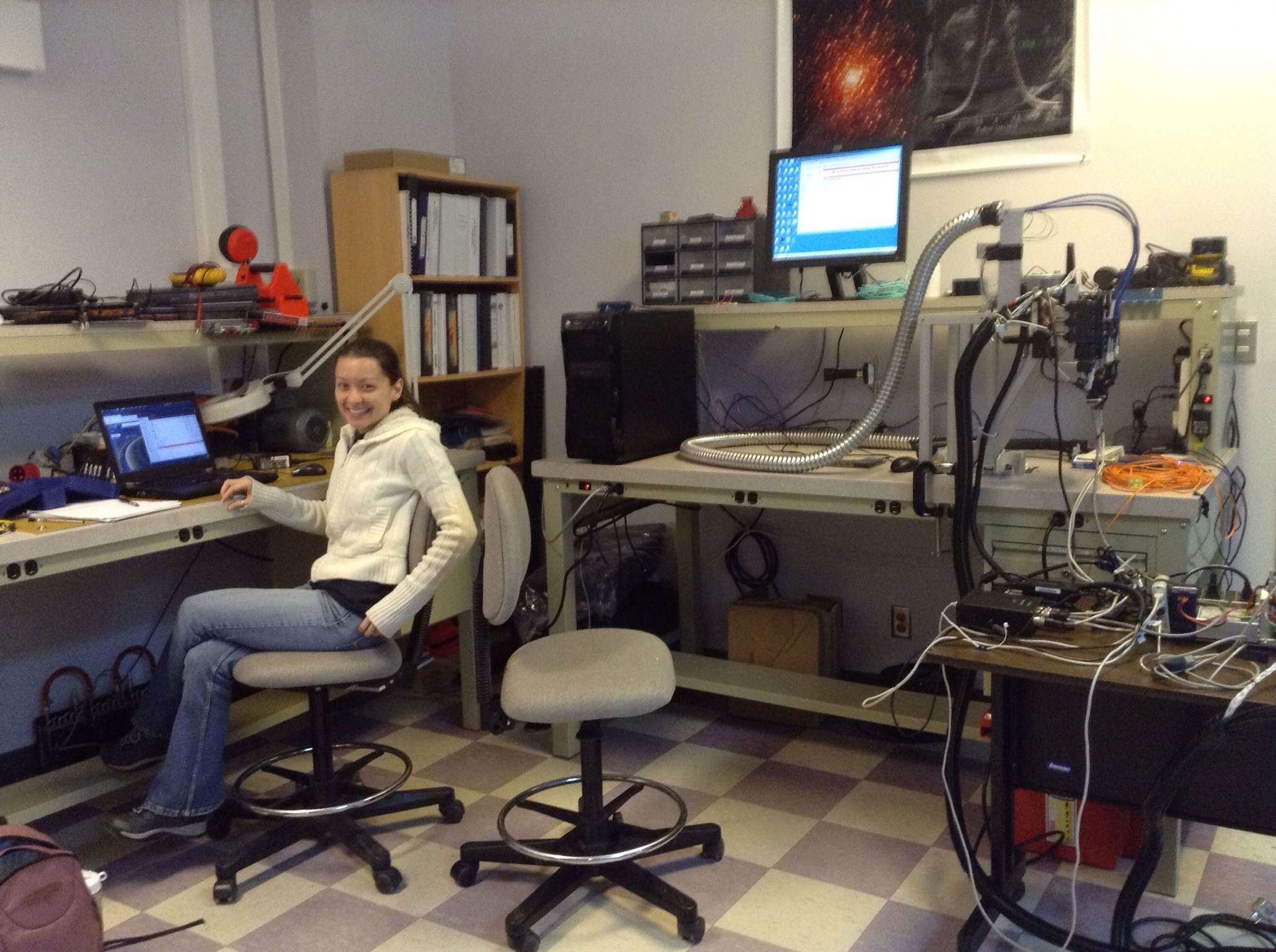 JoEllen with the failed instrument she tried to install on the SOAR telescope in Chile.