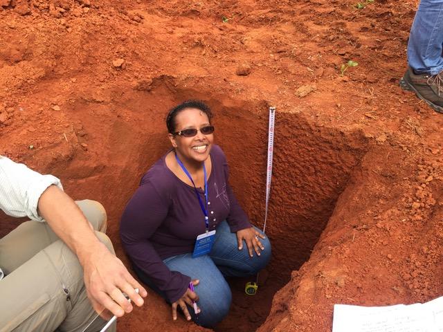 Asmeret inspecting soil profile.jpeg