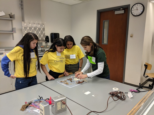 Explaining to middle school girls how seeds disperse at EYH 2018.