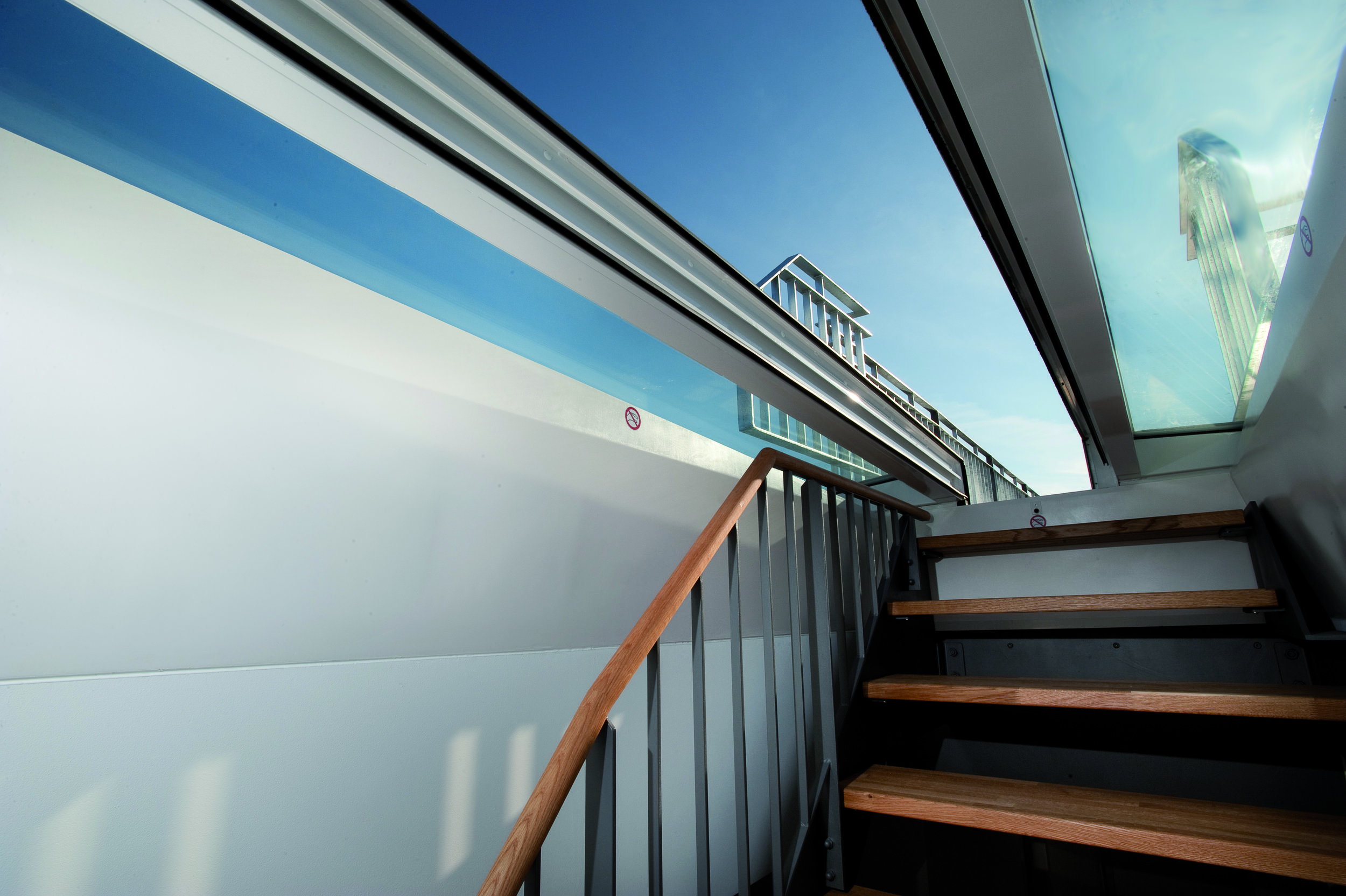 Sliding door high performance exit hatch, avoids the need for a bulkhead, allows roof access to rooftop gardens.