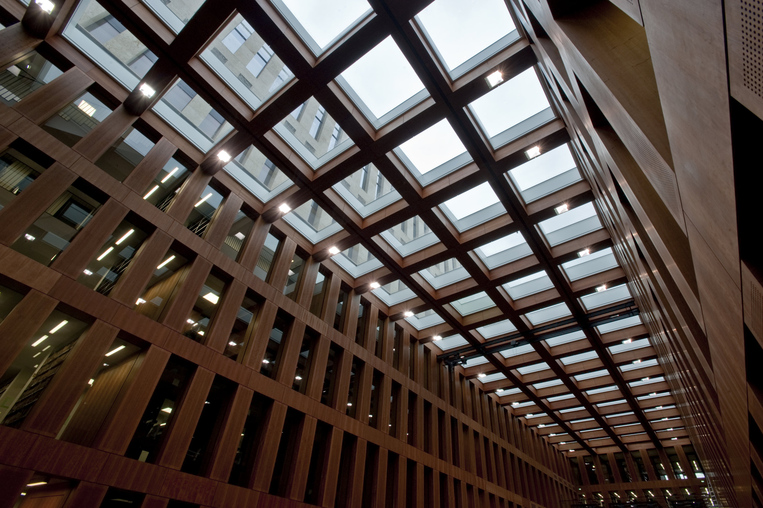 Glass roof systems provide daylight access to offices facing interior courtyard.