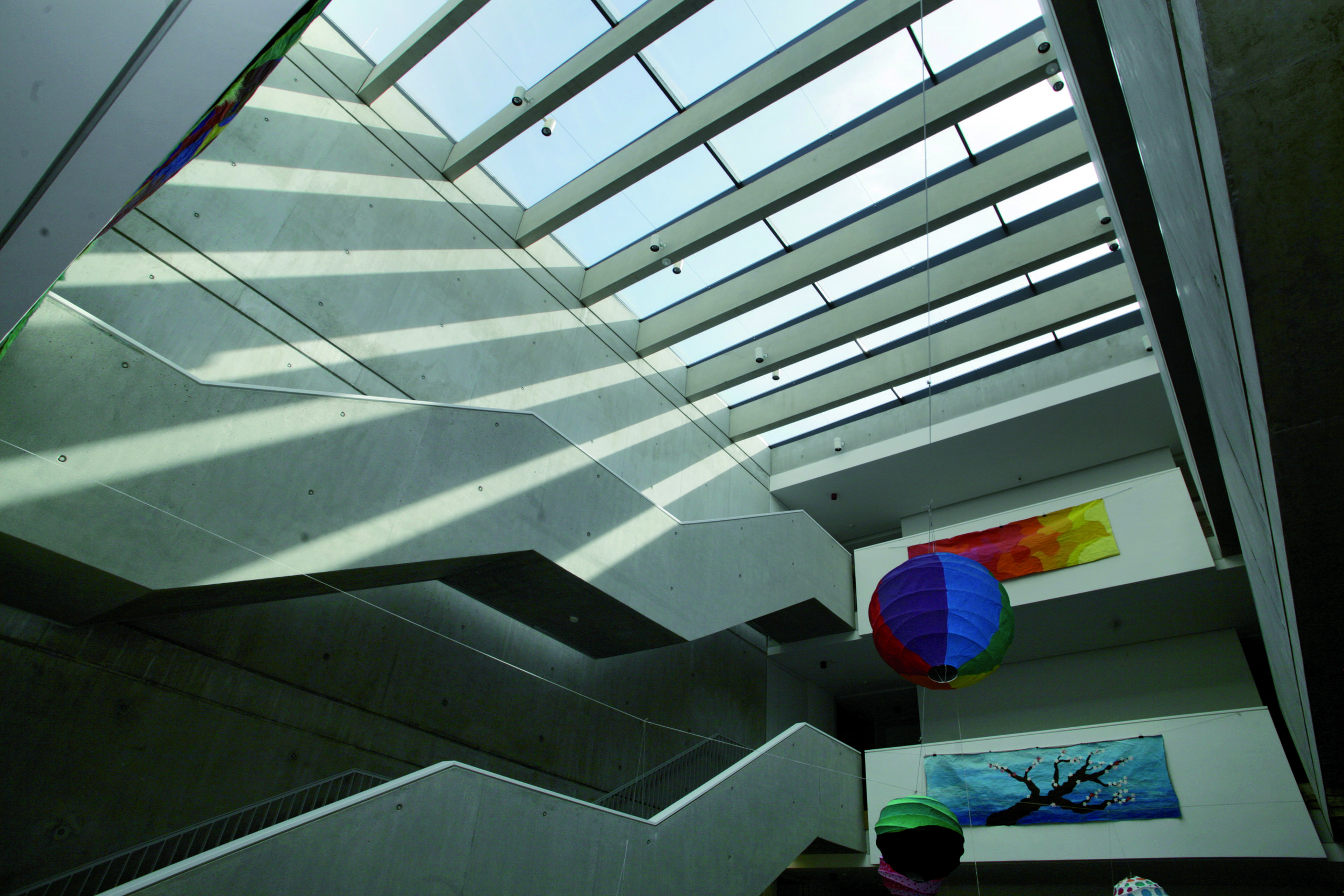 Play between light and structure enhance aesthetics of interior circulation space and make using stairs more attractive.