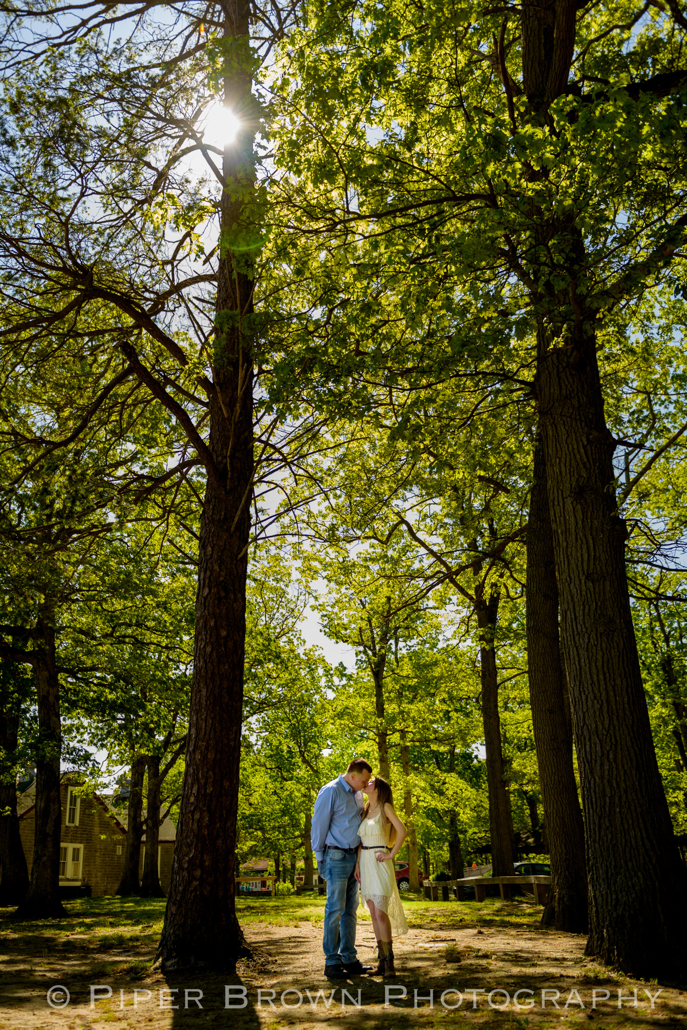 Man and woman kissing in a park