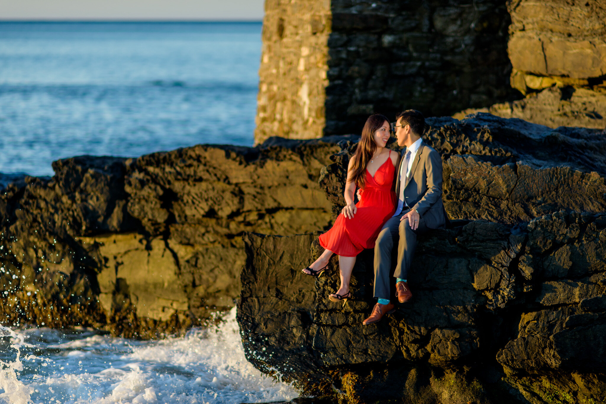 Man and Woman in a red dress at the sunrise