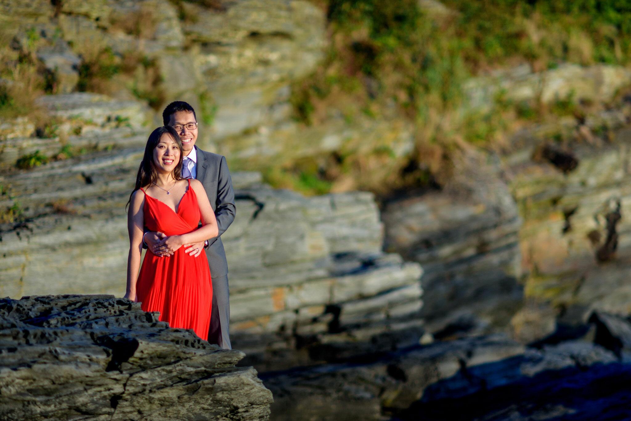 Couple enjoying sunrise at Newport Cliff Walk