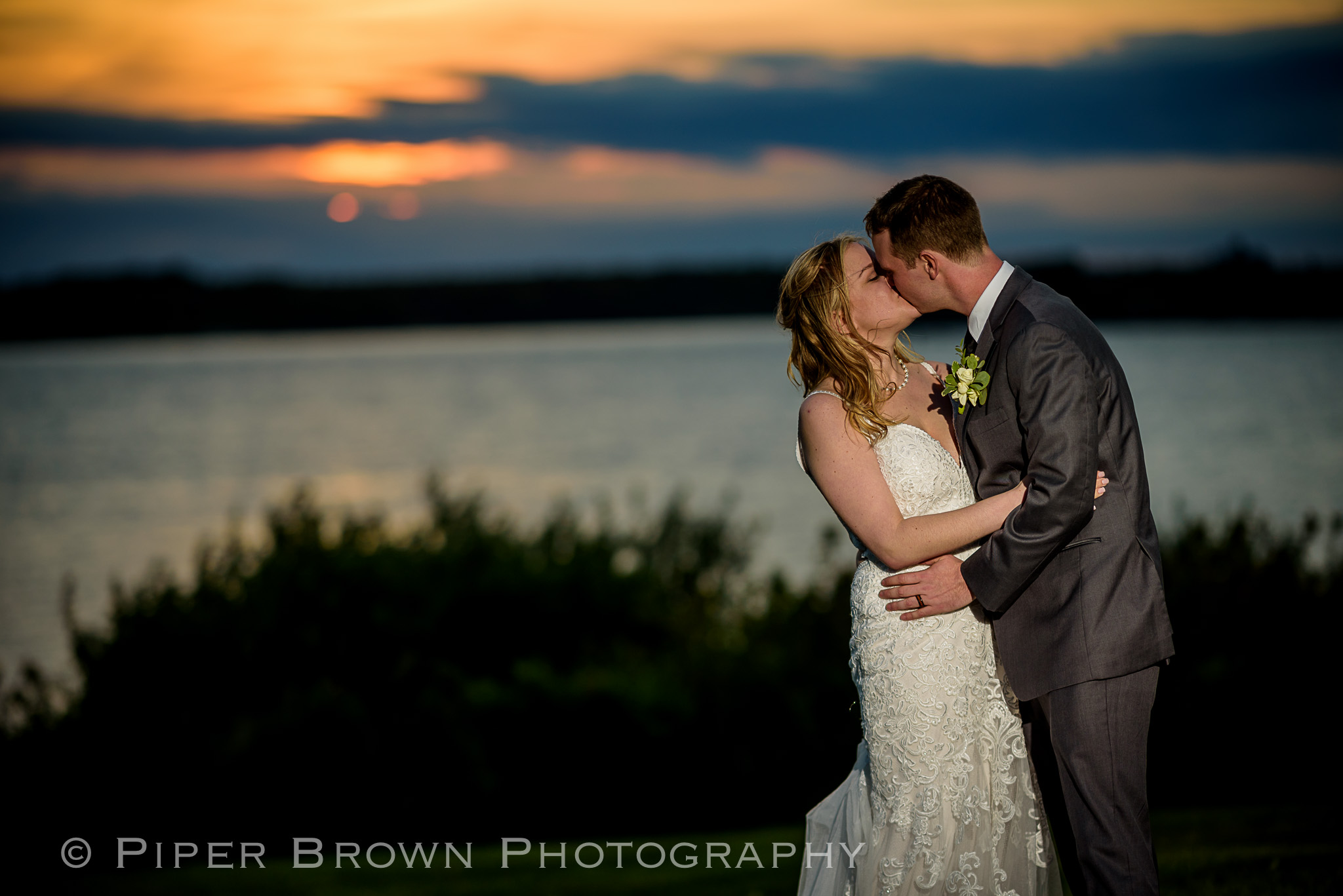 Bride and Groom kissing at sunset in Newport