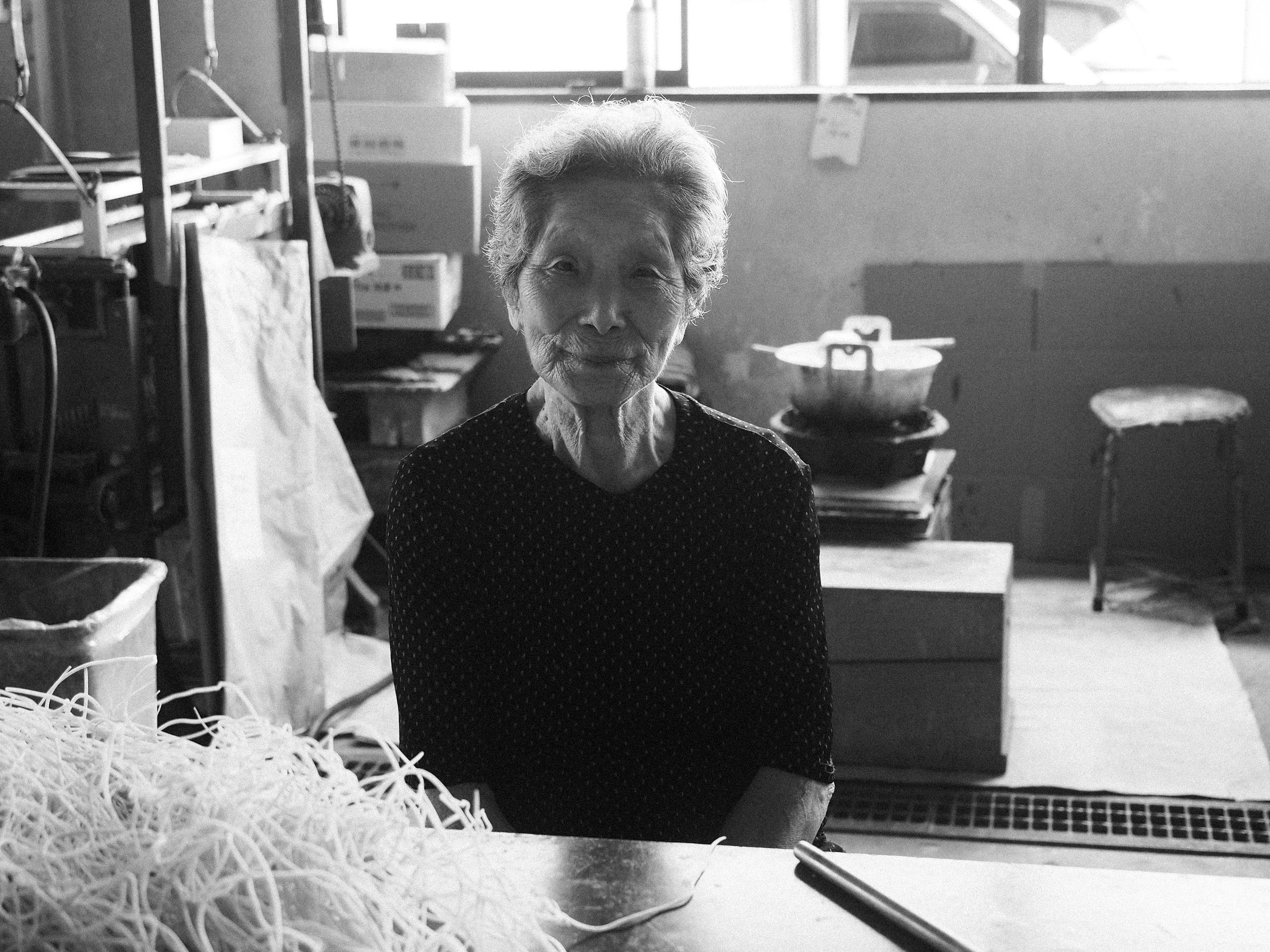 Satoshi's 92 year old grandmother, Miyo still works in the factory hand rolling the wicks usingrush cone (plant used for a tatami mat) wrapped around washi (Japanese paper).