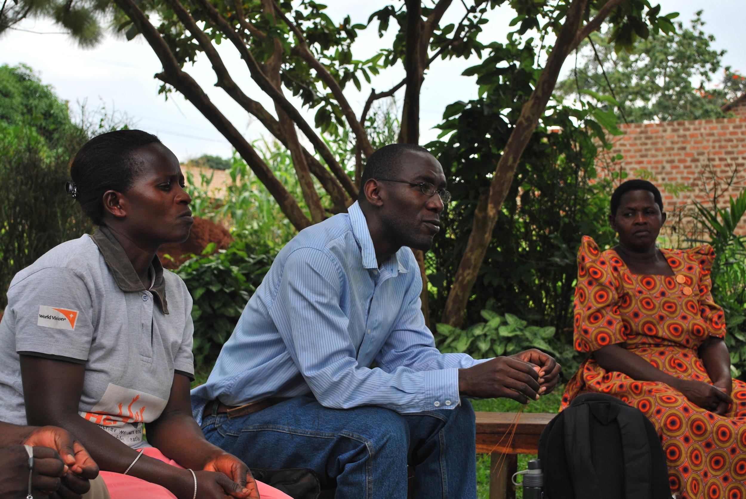 Dr. Robert Kalyesubula speaks during a community health meeting in Nakaseke.
