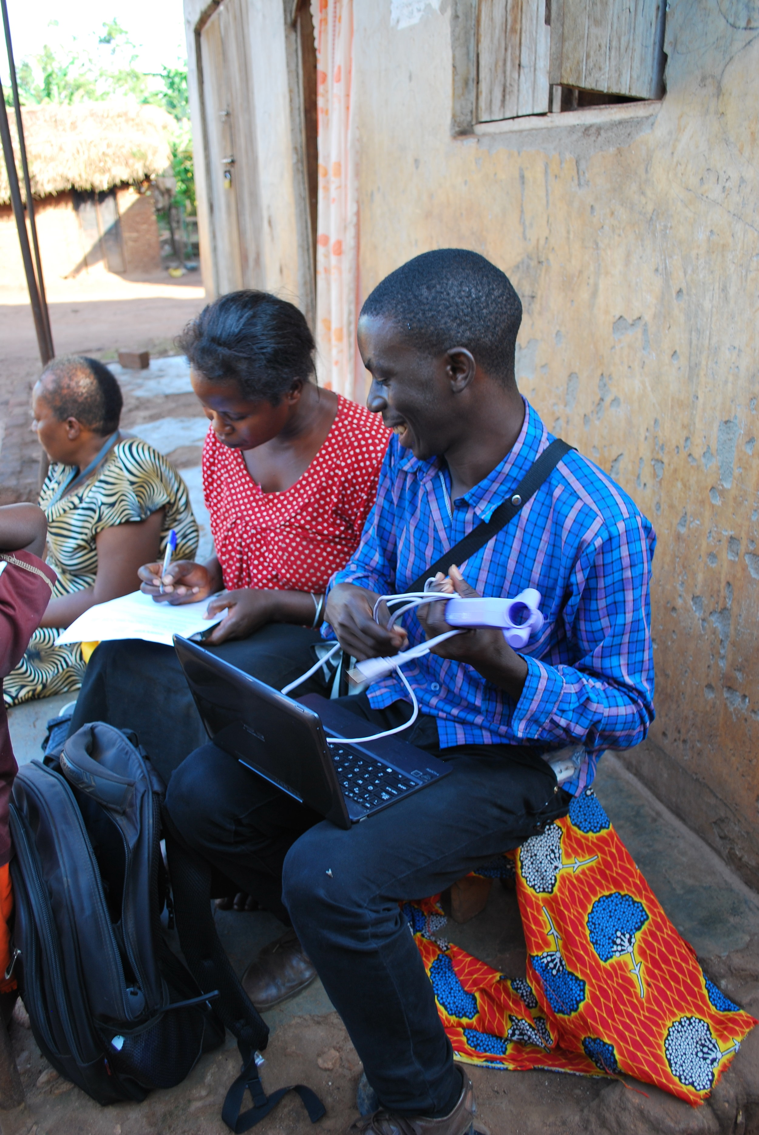 Field worker Denis receives informed consent from a study participant in Nakaseke.