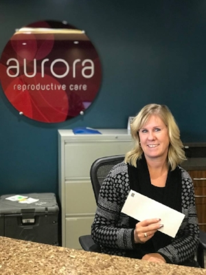 Delivering the $5,000 we raised from two online auctions and two events to Aurora IVF on behalf of our recipients