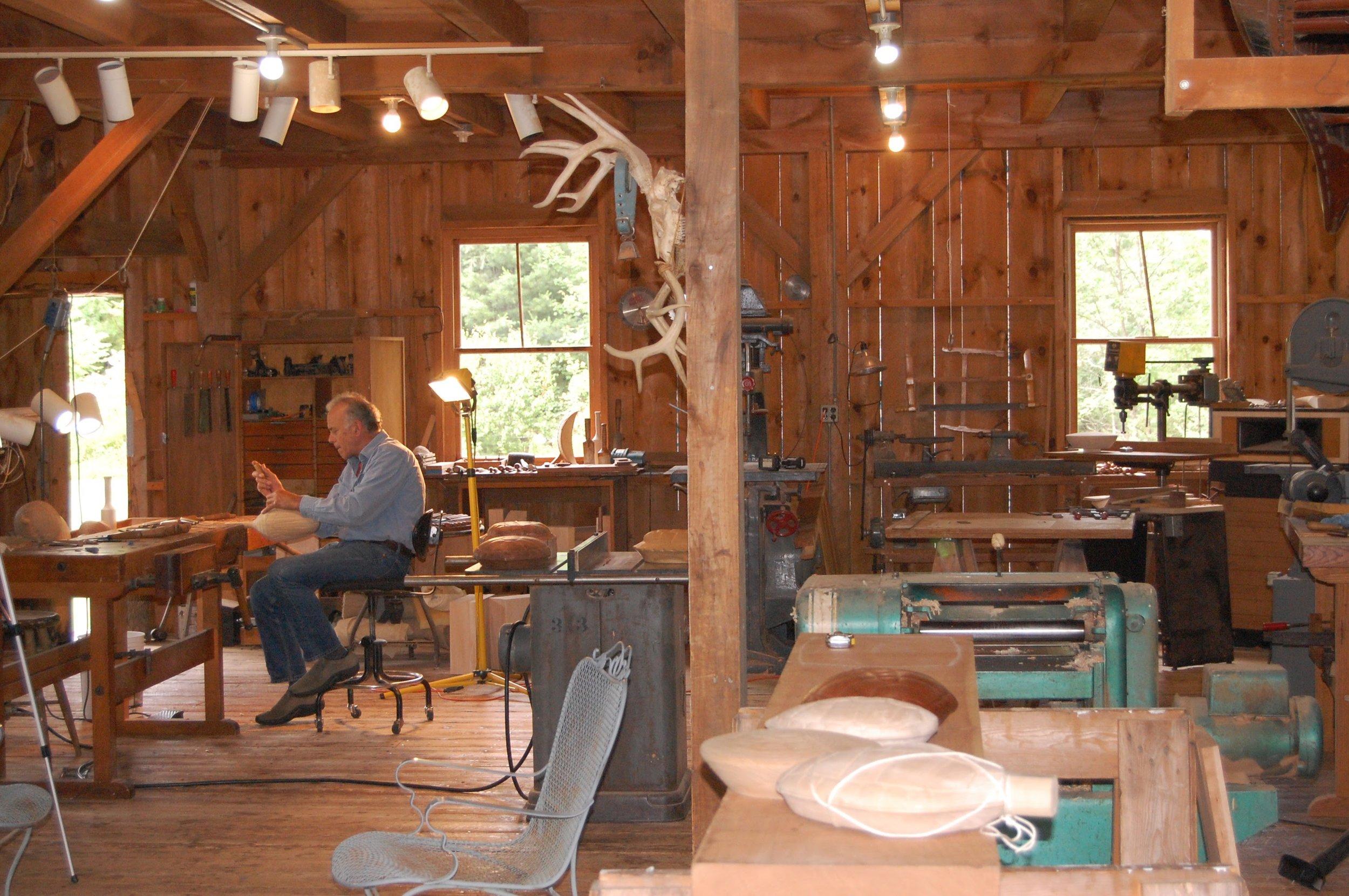 John Bryan at work, carving a chrysalis in his workshop.