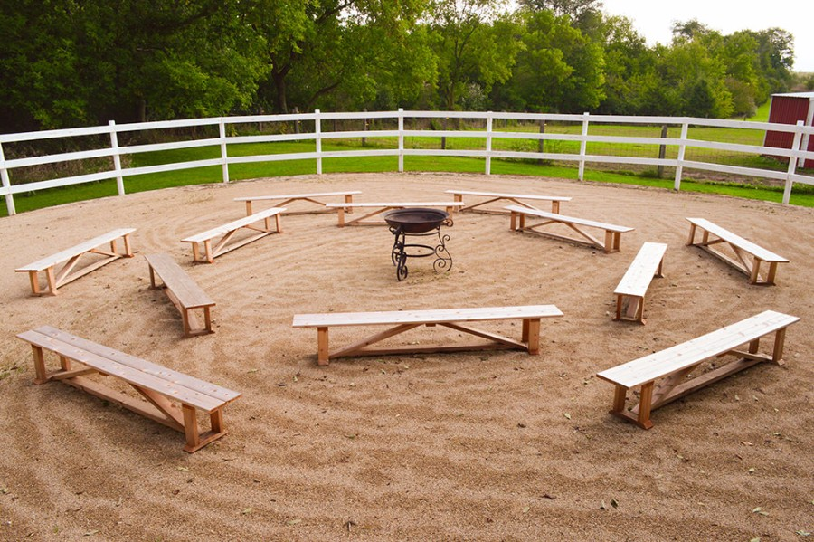 The Fire Pit – Cedar benches surround a raised copper fire pit. Hang high heels on the fence and go barefoot in the sand!