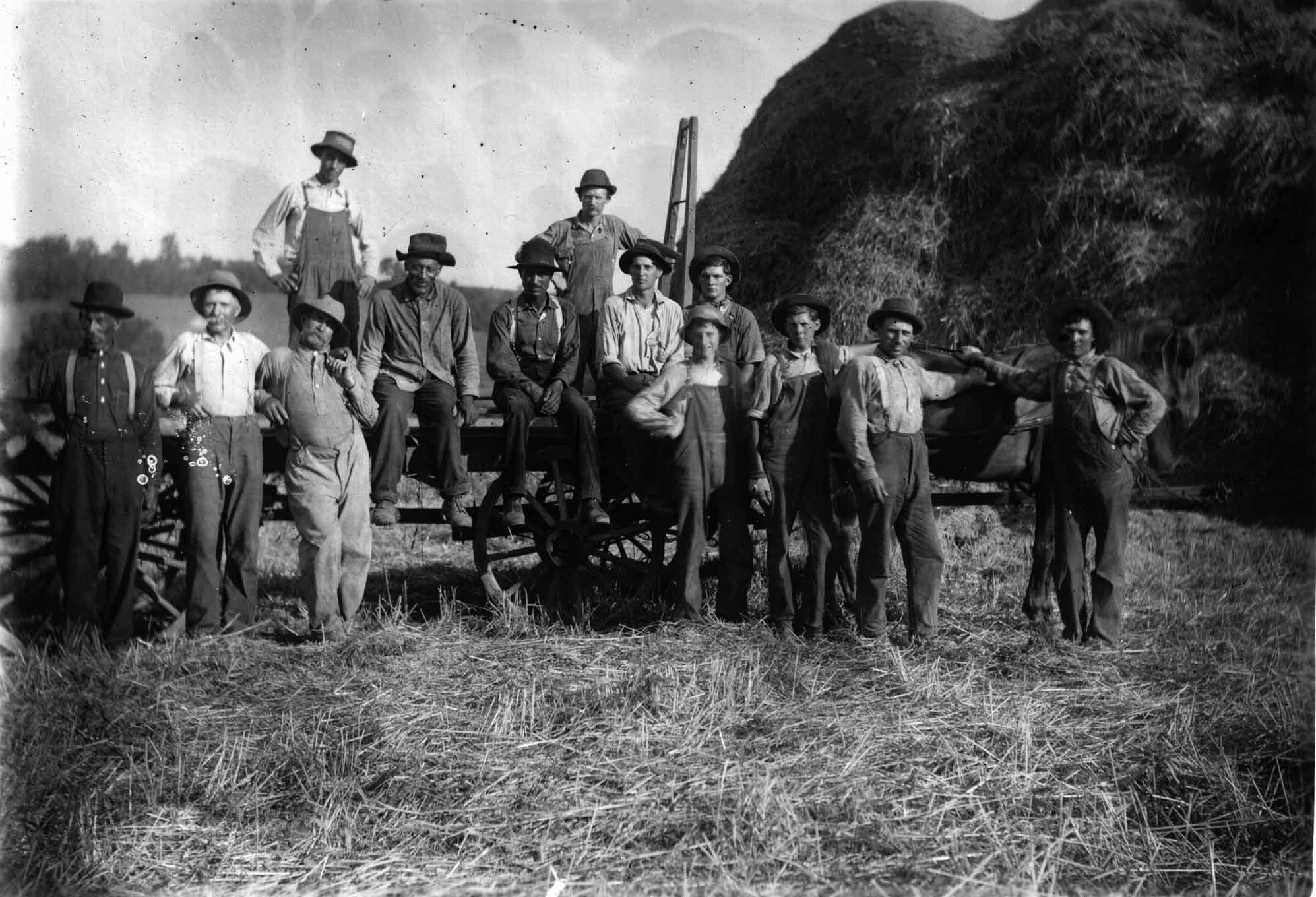 Field Crew circa 1900. Drovers would move hogs into Cincinnati and then work local farms as they head back out from Cincinnati. Here they are pictured harvesting wheat at the foot of Mt. Nebo.