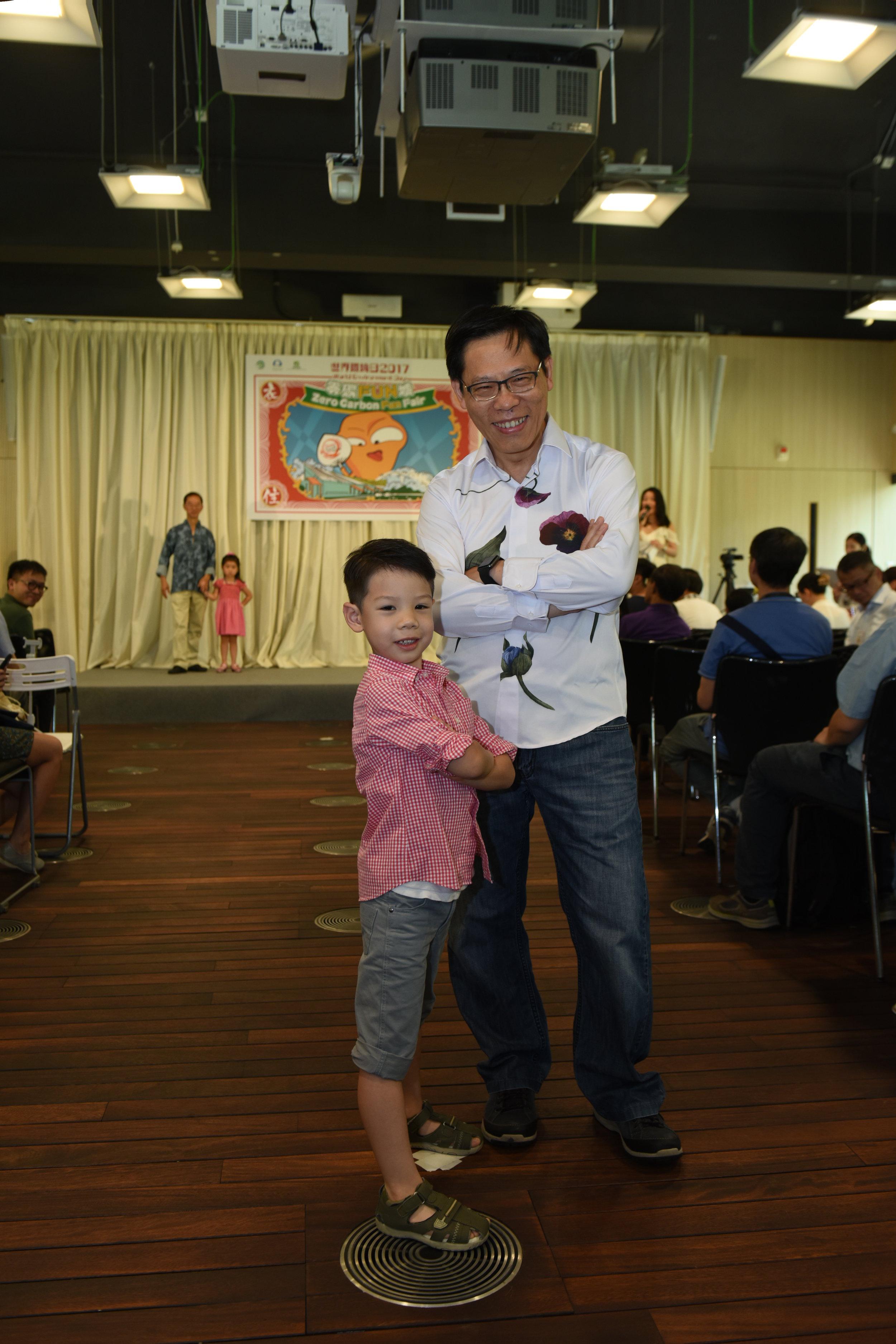Director of Environmental Protection Donald Tong wears Artisan