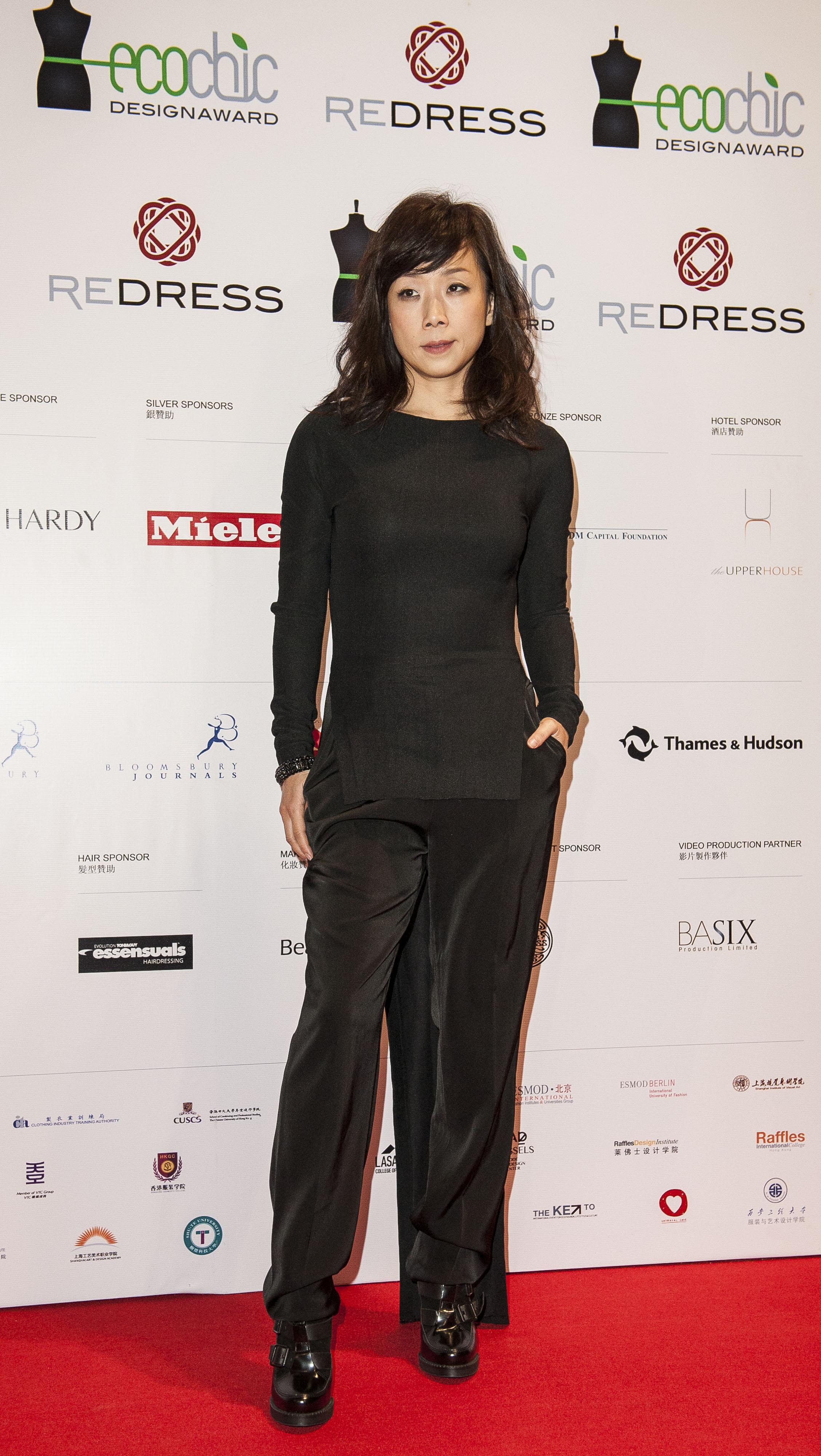Chinese singer Sandy Lam wears Wan & Wong to attend the Redress Design Award 2013 Grand Final Show