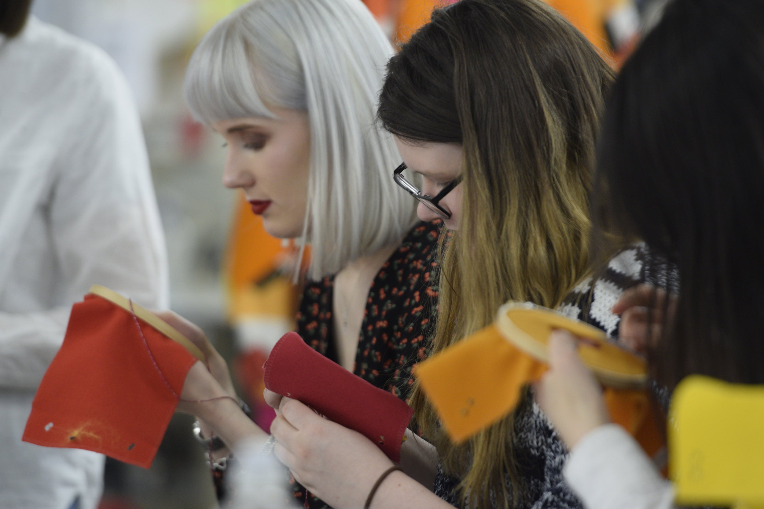 Students get to grips with 'Design for Repair' thinking at the Redress Design Award Fashion Academy