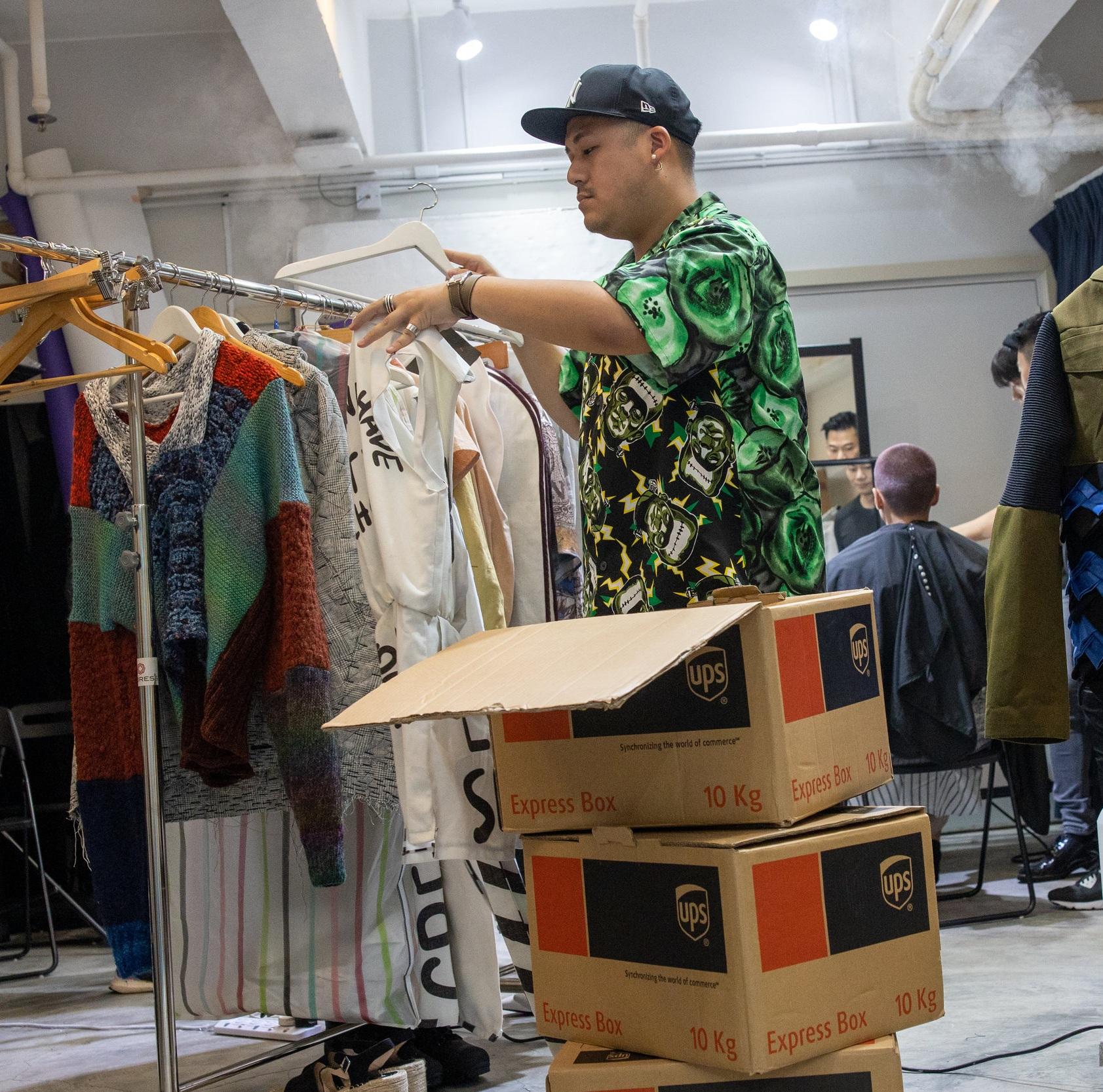 Stylist Kieran Ho arranging the garments for the photoshoot