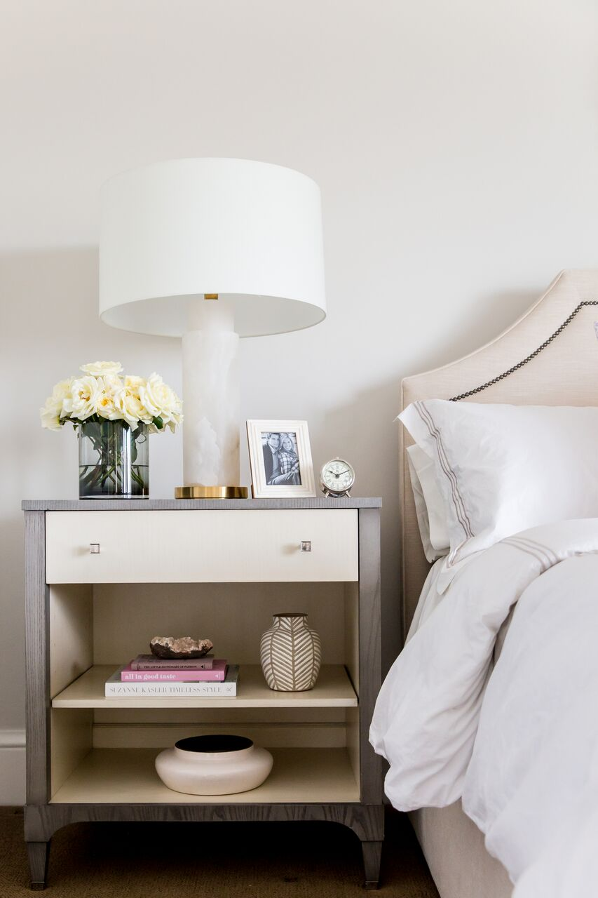 Our current nightstands have a big open space (without a shelf) that is incredibly hard to style. This photo though makes me entertain the thought of adding vases and books to fill and style the space.