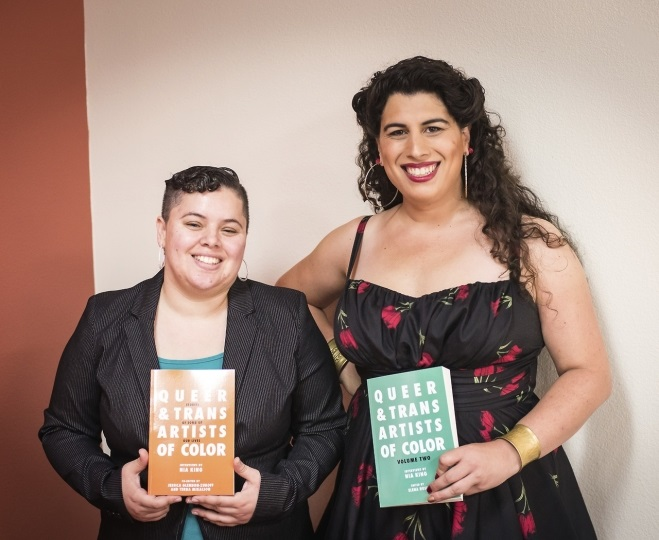 Nia King & Elena Rose, holding both volumes of Queer & Trans Artists of Color