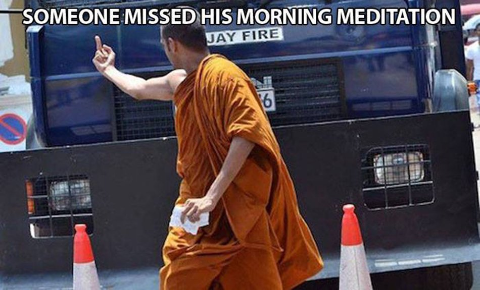 "Pictured: a white guy wearing orange Buddhist monk robes, flipping off someone out of frame. The caption reads, ""Someone missed his morning meditation."""