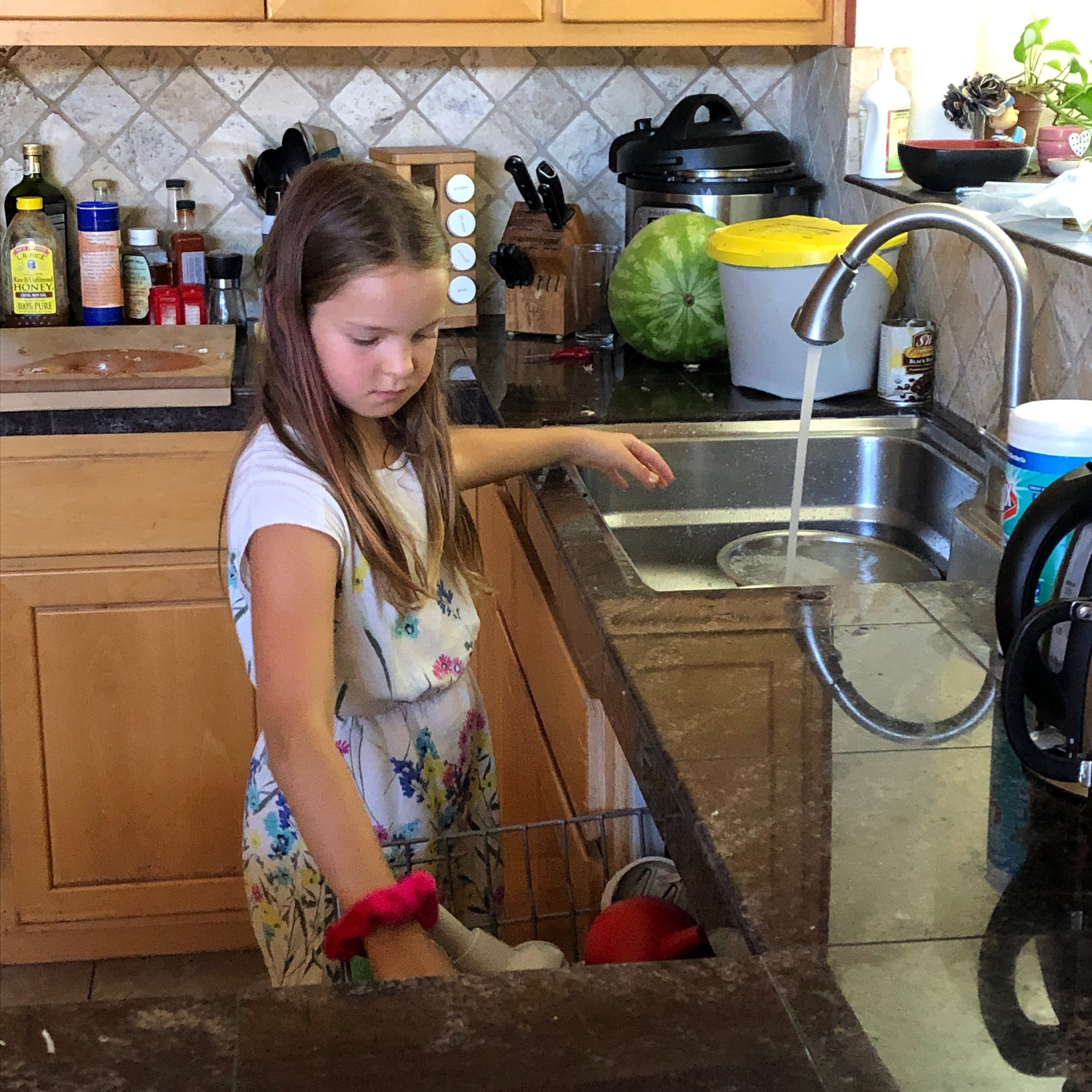"""Little Chef"" cleans up after making ranch dressing from scratch, which included a bike ride with her brother to the grocery store for a missing ingredient."