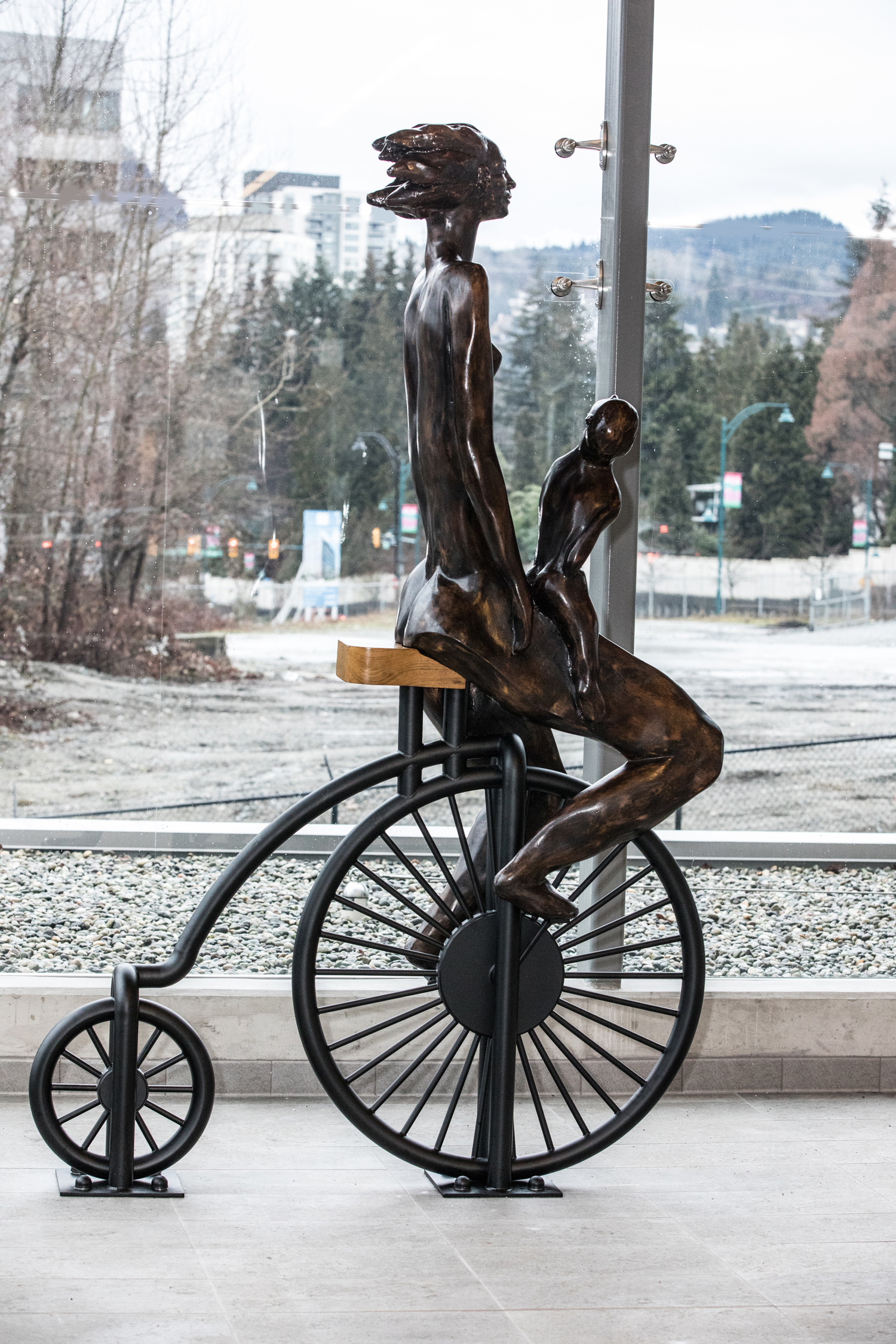 Mother and Child on a Bike located at Port Moody skytrain 9 feet fiberglass and iron