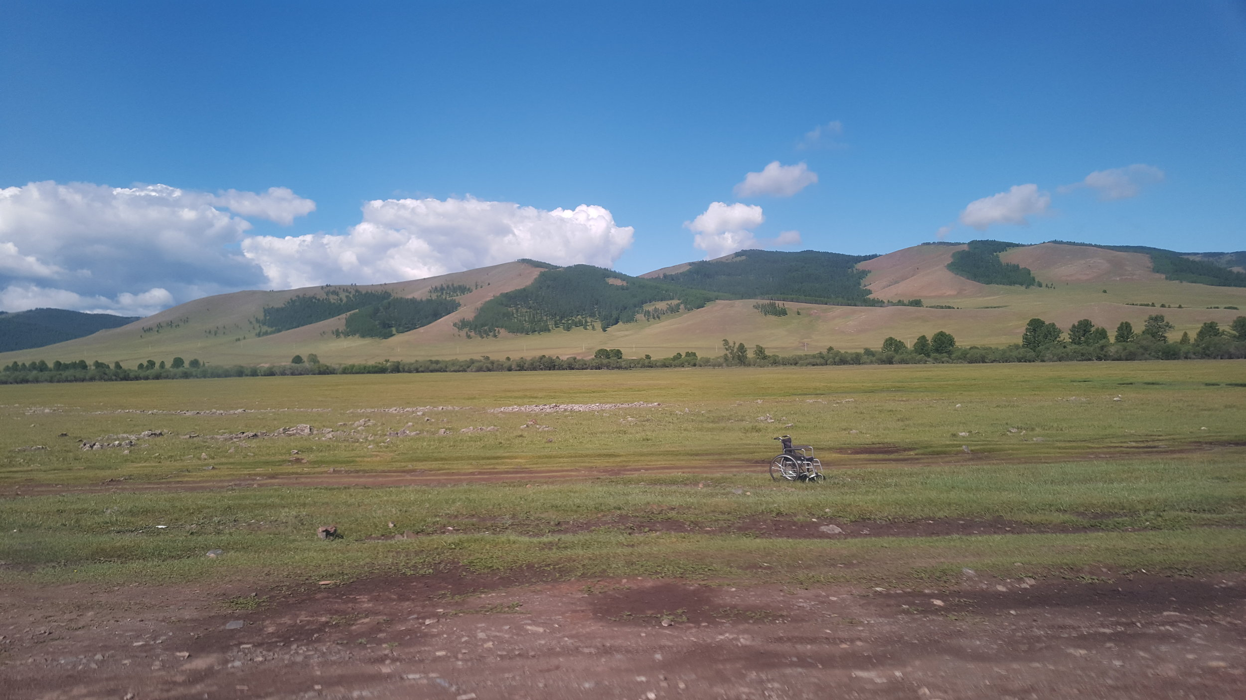 A poignant image, a wheelchair empty, in the middle of the steppes.
