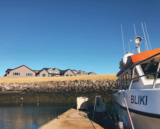 Berg, sitting above the small marina on a sunny day.  #hotelbergiceland #keflavik #reykjanes #inspiredbyiceland