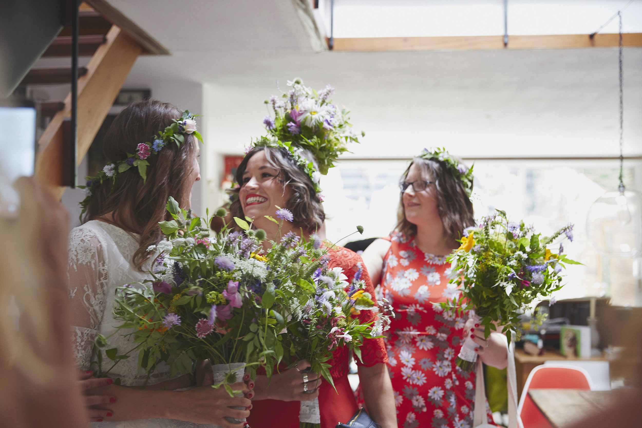 Bride and bridesmaid hidng in the flowers!