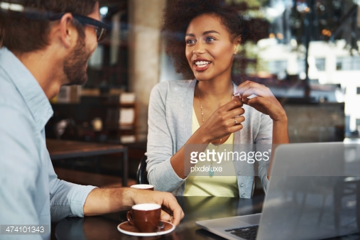 http://www.gettyimages.com/detail/photo/business-people-talking-in-cafe-royalty-free-image/457983989