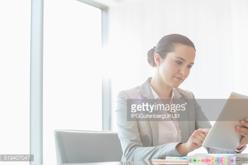 http://www.gettyimages.com/detail/photo/businesswoman-holding-digital-tablet-royalty-free-image/465892541