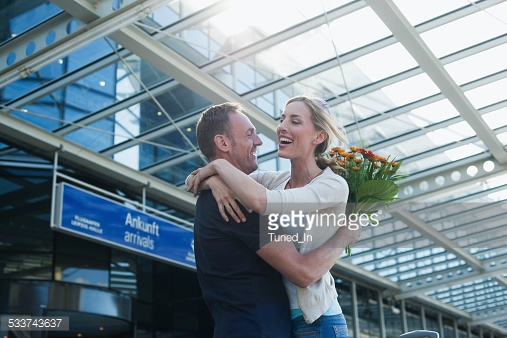 http://www.gettyimages.com/detail/photo/couple-embracing-at-airport-high-res-stock-photography/529578304