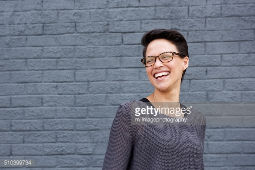 http://www.gettyimages.com/detail/photo/close-up-portrait-of-smiling-woman-royalty-free-image/522796511