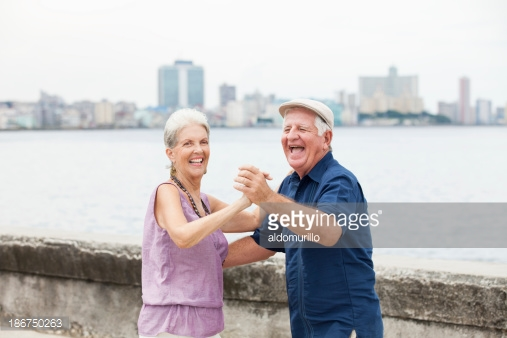 http://www.gettyimages.com/detail/photo/senior-hispanic-couple-dancing-outdoors-royalty-free-image/109348282