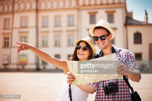 http://www.gettyimages.com/detail/photo/caucasian-couple-checking-photos-on-digital-camera-royalty-free-image/580496441