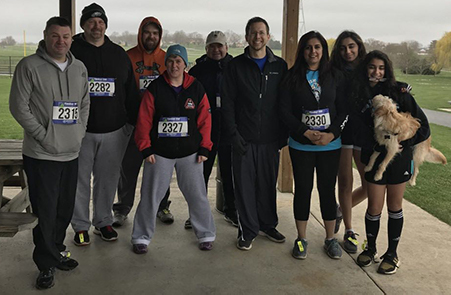 Foxhole Technology employees and who braved the cold to run and walk for this great cause are from left: Mark Malonis, Jeff Bert, Tom Kershner, Dee Rider, Stewart Kerr, Joe Burke and Monika Segal; and family members, Neha Sehgal and Simran Sehga (and their dog).