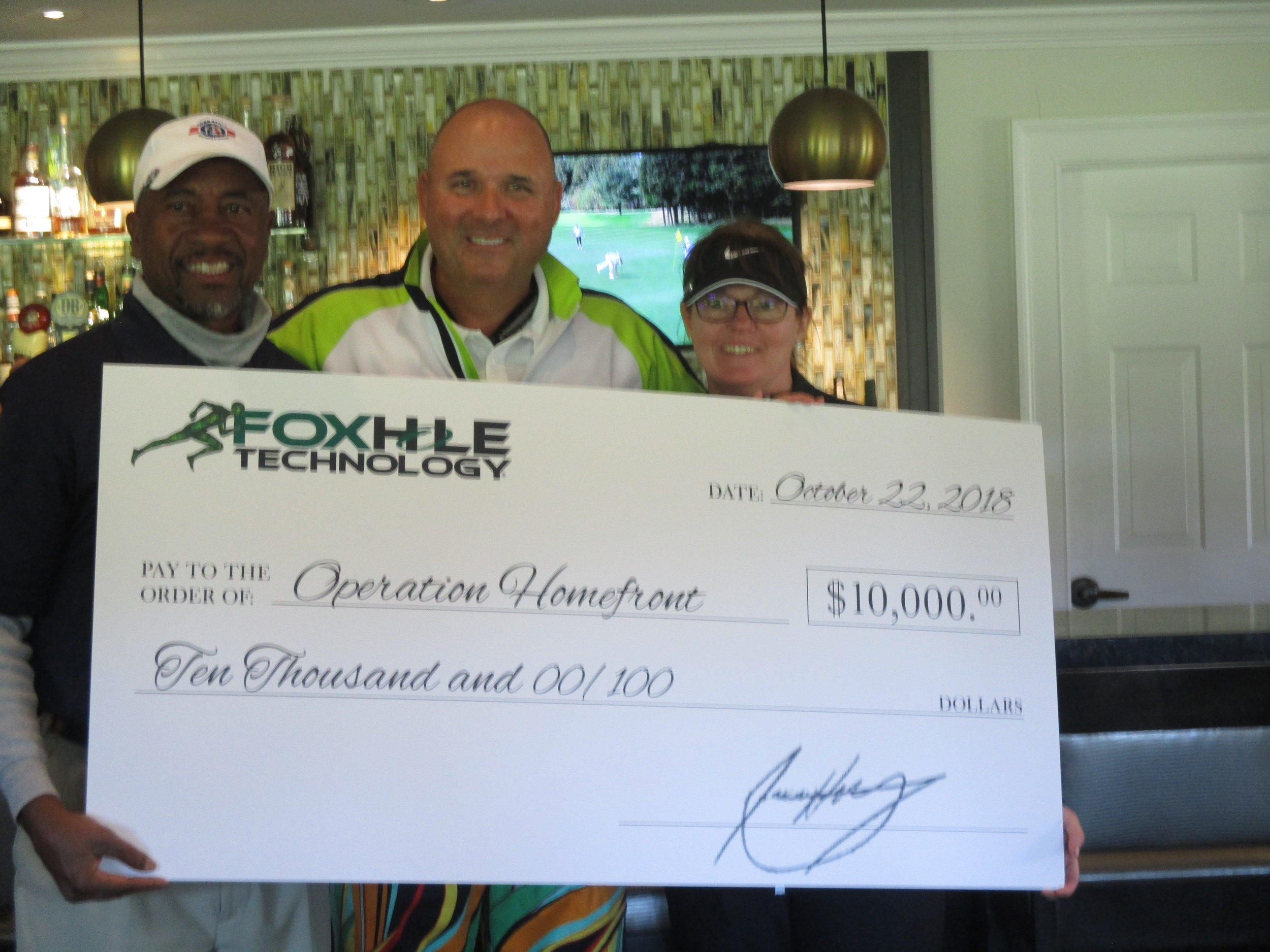 Wes Hester, CEO, Foxhole Technology presents Bruce Anderson and Shannon Grynkewich of Operation Homefront with a $10,000 check from proceeds from the Foxhole Technology Charity Golf Tournament.