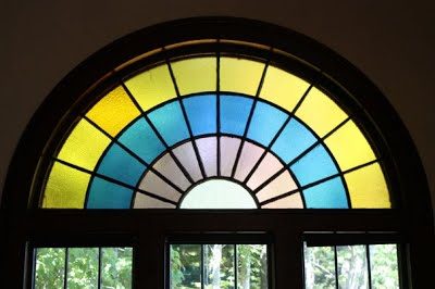 Stained glass windows make The Hall both vibrant and cozy.