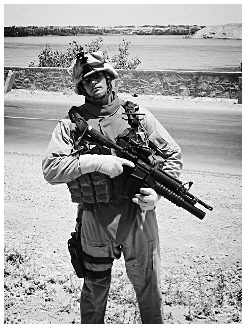 Sgt James Bane on the banks of the Euphrates, 2006