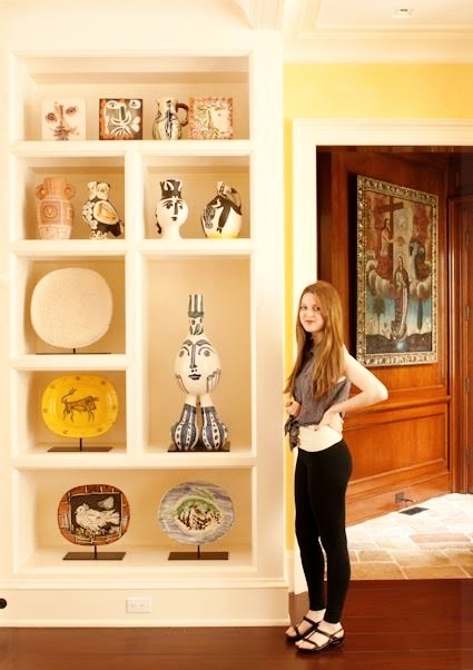 Sam at home with art collection - interior design, home, display, ceramics, pottery, paintings