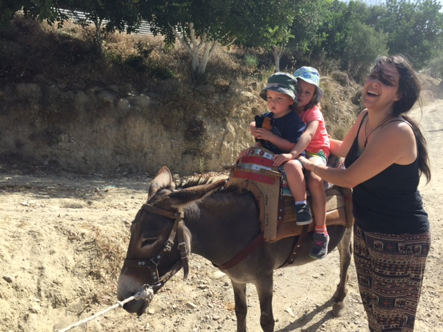 Riding Louiza, the donkey. They look petrified here, but they actually loved it.